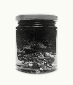 photographer Christoffer Relander utilizes mason jars as vessels to capture the environments that surrounded him during his childhood in Finland. The project, Jarred & Displaced, utilizes double exposures shot on medium format film to combine pristine images of jars with black and white landscapes, collecting scenes shot within forests, neighborhoods, and on top of steep ridges.