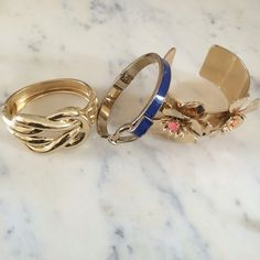 Bundle of Three Gold Bangles Three gold bangles in mint condition. Large one with flowers is J.Crew and slides on arm. The other two are Talbot's and open up. The J.Crew alone retails for over $40! J. Crew Jewelry Bracelets