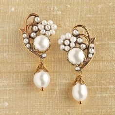 Jewelry: These earrings are handcrafted in Italy using brass and freshwater pearls for a classic look and feel. Caserta Palace Pearl Earrings | National Geographic Store