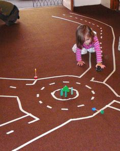 Masking tape road for toddlers and kids. Great indoor activity!