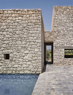 4 Enchanting Moroccan Villas by French Duo Studio KO - Photo 10 of 10 - Villa DL has small roofless courtyards, and a central patio reminiscent of the types found in ancestral farmsteads in the nearby countryside. Minimalist Architecture, Facade Architecture, Contemporary Architecture, Stone Facade, Stone Masonry, Stone Siding, Stone Veneer, Facade Design, Patio Design