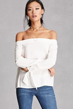 A woven top featuring an off-the-shoulder collar, long sleeves with asymmetrical cuffs, and a boxy silhouette. This is an independent brand and not a Forever 21 branded item.