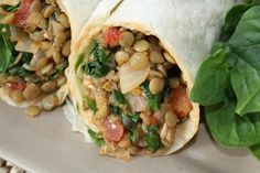 Lentil Spinach Burritos.   Serving suggestion: top with greek yogurt and avocado and add a side salad.