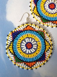 Beadwork Hoop Earrings Tribal Inspired Big Bold Colorful Hoop earrings Seed bead hoop earrings made with multicolored rainbow 11.0 seed beads. These stunning earrings will certainly get lots of attention. Inspired by the magnificently beautiful and colorful jewelry of South Africa. The