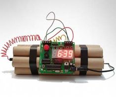 Defusable Bomb Alarm Clock. Want an alarm clock that doubles as a Hollywood movie style bomb? This defusable bomb is a fully functional alarm clock with a snooze button, but when you press the big red button a scary countdown will start requiring you to cut the right wire before time runs out.  #cool