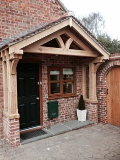 Green oak porch • Old English Doors Outdoor Canopy Gazebo, Porch Canopy, Porch Swing, Porch Uk, Porch Roof, House With Porch, Solid Oak Doors, Oak Frame House, Front Porch Design