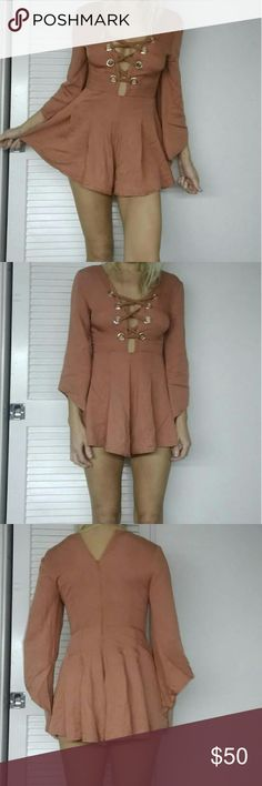Nwt LF Angel B blush nude roped neckline romper So cute! I have an elongated torso which means these are always extra short on me.. this one is a sick cut abd gorgeous detailing. Size uk 8  .us 4. Im 5'9 26w 34b and 32c and its perfect.. except for my torso. Nwt LF Pants Jumpsuits & Rompers