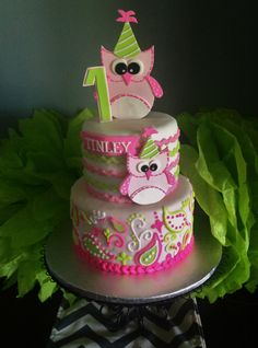- Owl 1st Birthday cake.  Fondant with piped buttercream paisley.  Owls are gumpaste.