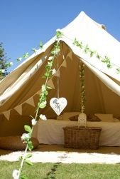 bell tent decked out with bunting and garlands make a lovely 'garden room'