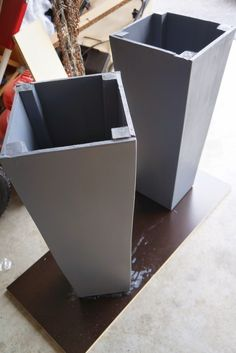 DIY tall square planters, I would cut the supports/frame pieces a little shorter depending on what you will plat. That way to soil will sit above them and they won't be seen. Especially if you are planting topiary's.