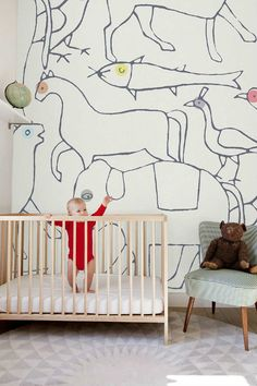 Cute and child like parade of creatures   10 Wonderfully Whimsical Nurseries - Tinyme Blog