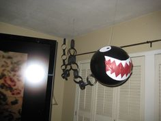 Super Mario Party - Made Chomp Chomps out of balloon and paper chain links. Move around while hung from fishing line when people would walk by. Super Mario Bros, Super Mario Birthday, Mario Birthday Party, Super Mario Party, 6th Birthday Parties, Boy Birthday, Birthday Ideas, Mario Party Games, Fete Emma