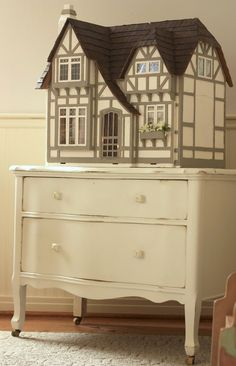 dollhouse on a short chest of drawers. I sure hope I have a girl so that a dollhouse makes sense in our house. I don't know any boys that would be into my mauve and teal Victorian dollhouse!