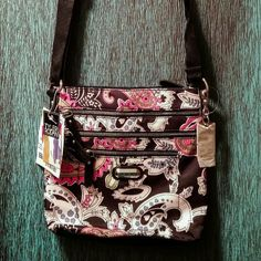 Crossover Purse Crossover purse with zipper pockets, one snap pocket on outside, zipper and loose pockets on inside. Tyler Rodan Bags Crossbody Bags