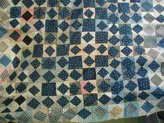 An antique 1800s quilt top made from indigo shirting.
