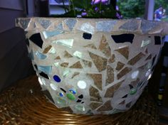 This is a recycled plastic pot made into a planter..saving the planet bit by bit..