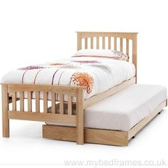 High quality high footend solid oak constructed bed frame with an attractive slatted design. Extra bed for guests stored underneath main frame. Single x Supplied by Serene Furnishings