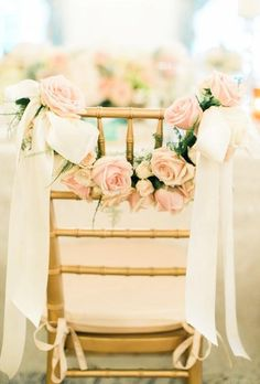Rose and ribbon garland wedding chair decor ideas