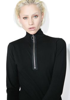 Slick Zip Long Sleeve Top ya sure know how to charm 'em, BB~ This badazz top features a stretchy 'N form fitting black construction, turtleneck, and sikk half-down zip front closure with O-ring pull tab.