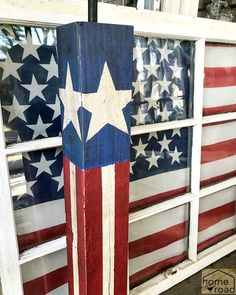 DIY Wooden post firecracker DIY and a flag draped window. Homeroad.net #fourthofjuly #fireworks #firecracker #diyproject #fourthofjulydecor #redwhiteandblue #starsandstripes #summer #summerideas #familyfun #summerproject