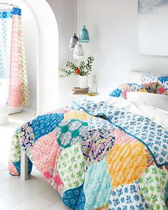 Pieced from 10 prints and one solid, this bright, hand-quilted bedding captures the beauty of Scandinavian floral and paisley textiles. Vertical rows of oversized hourglass-shaped pieces modernize the classic look.
