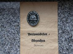 "Wound Badge Black marked ""A"" with enwelope by Assmann."
