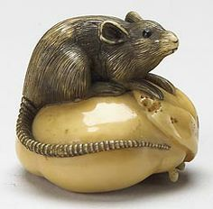 Rat on a persimmon ivory netsuke by Nobuyuki, late 19th century