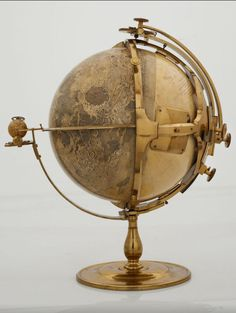 Needless to say, the steampunk interior design style certainly creates an entirely new look in a . These are a must for a steampunk bedroom. Vintage Maps, Vintage Antiques, Vintage Market, Globes Terrestres, World Globes, Snow Globes, Steampunk Kitchen, Steampunk Bedroom, Dream Library