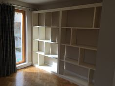 The simple lines of this open box style unit really work in this modern interior. Bespoke shelving @ Christy Bird's