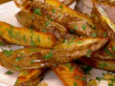 Butter-Garlic Oven Fries with Herbs Recipe : Jeff Mauro : Food Network - FoodNetwork.com