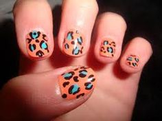 Rawr!!  Cheetah print nails.  Bold colors- teal and tangerine.