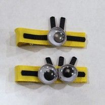 Who doesn't love minions?  Pair of minion clips ( one left and one right) Also has snowflakes and snowmen, princess clips and hello kitty!