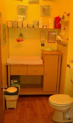 daycare bathroom / diaper area A changing table or large dresser with shelving to organize each child's items but keep them all in one area- good for napping room if theres no room in the bathroom!
