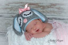 Easter is coming and this is the perfect newborn photo prop for those spring pictures! Hat made of a soft chunky gray yarn and adorned with two big floppy ears lined with white and blue (or pink). This adorable little bunny has two sleepy eyes, a pink nose and each hat comes with a