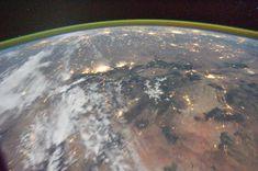 View from aboveThis image provided by NASA shows a night time image photographed by the Expedition 29 crew from the International Space Station on Oct. 16, 2011. It features airglow, Earth's terminator, Rocky Mountains, Denver-Colorado Springs (center-right), Santa Fe-Albuquerque (low-center-right), US Great Plains cities: Dallas-Oklahoma City, Kansas City and Chicago