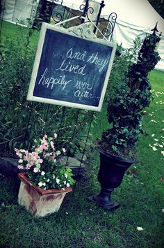 Chalkboard and toperies..a must!  (chalkboard is hung on garden trellis)
