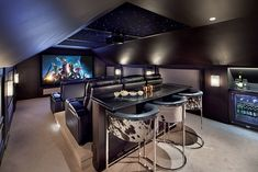 Great Spaces: A Killer Home Theater - Arlington Magazine - Home Cinéma Home Theater Room Design, Movie Theater Rooms, Home Cinema Room, Home Theater Setup, Home Theater Seating, Attic Theater, Theater Room Decor, Home Theatre Rooms, Attic Movie Rooms