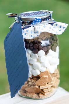 S'mores Bar Mix in a Jar!  I know you dont want jars, but its a cute idea that could maybe work with bags!