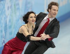 Nathalie Pechalat and Fabian Bourzat of France compete in the team ice dance short dance figure skating competition at the Iceberg Skating P...