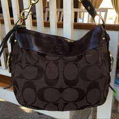 COACH Brown Signature Carly Purse COACH, brown canvas and leather, signature Carly purse.  Purse has zip closure, two inside slip, and one inside zip pockets.  In general good condition.  Minor signs of wear but really a beautiful purse!  Pictures don't do justice. 10x13x4. Strap drop 4 inches. Coach Bags Shoulder Bags