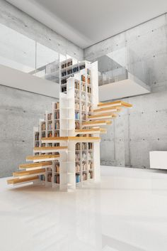 This spiral- #staircase #bookshelf also has a secret cubby where no one can see you weeping at the end of a good book. |\ #books #architecture #bookshelves