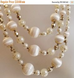 This #vintage wedding white beaded necklace is just incredible!  It features a three strand necklace with a combination graduated gold glitter, faceted gold crystal, popcorn... #ecochic #etsy #jewelry #jewellery