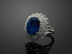 A sapphire, diamond and 18k white gold ring, accompanied by a SSEF certificate stating that the 14 cts sapphire, origin Burma, shows no indication of heating.
