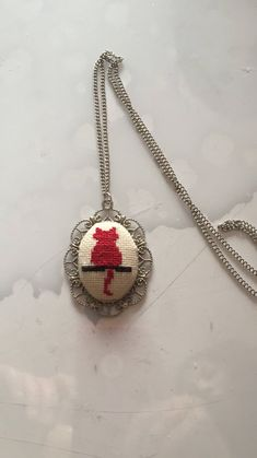 A personal favorite from my Etsy shop https://www.etsy.com/listing/593365319/cat-pendant-cat-necklace-crossstitch-cat