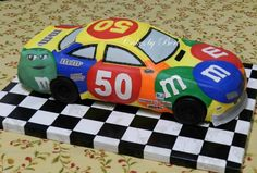 Kyle Busch #18 Nascar.  The car number is the birthday girls age!  Carved out of 2 - 12x18 chocolate sheet cakes.