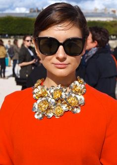 Amazing statement necklace at Paris Fashion Week. Details in street style.