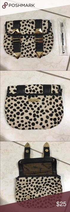 Rebecca Minkoff Clutch I've gotten this a long time ago so it's practically Rebecca Minkoff vintage. I love using it as a clutch to store your cards cash phone lip gloss etc. magnetic closure. Rebecca Minkoff Bags Cosmetic Bags & Cases
