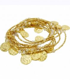 "Add a little bohemian flair to your wardrobe with this versatile sun disc wrap necklace. Plated with 24ct Gold on a hand textured Brass base. Features textured gold coins interspersed with semi precious stones. Create different looks by layering, or simply wear it long. Can also be wrapped around your wrist to be worn as a charm bracelet.    Wear as Necklace or Charm bracelet.    Necklace measures 70"".    Made by Azuni."