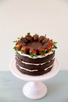 Amazing chocolate cake recipe with a strawberry swiss meringue buttercream and chocolate ganache.