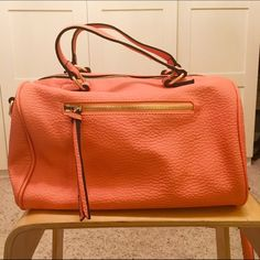 STITCH FIX Marsha Bowler Satchel Bag in CORAL NWOT this is a bowler bag from stitch fix by urban expressions. It comes with a crossbody strap. The lining is an adorable black and white print. The bag itself has contrasting black on the sides of the straps which really makes it pop. Zippers and buckles are gold. This is the perfect spring every day bag! Stitch fix Bags Crossbody Bags